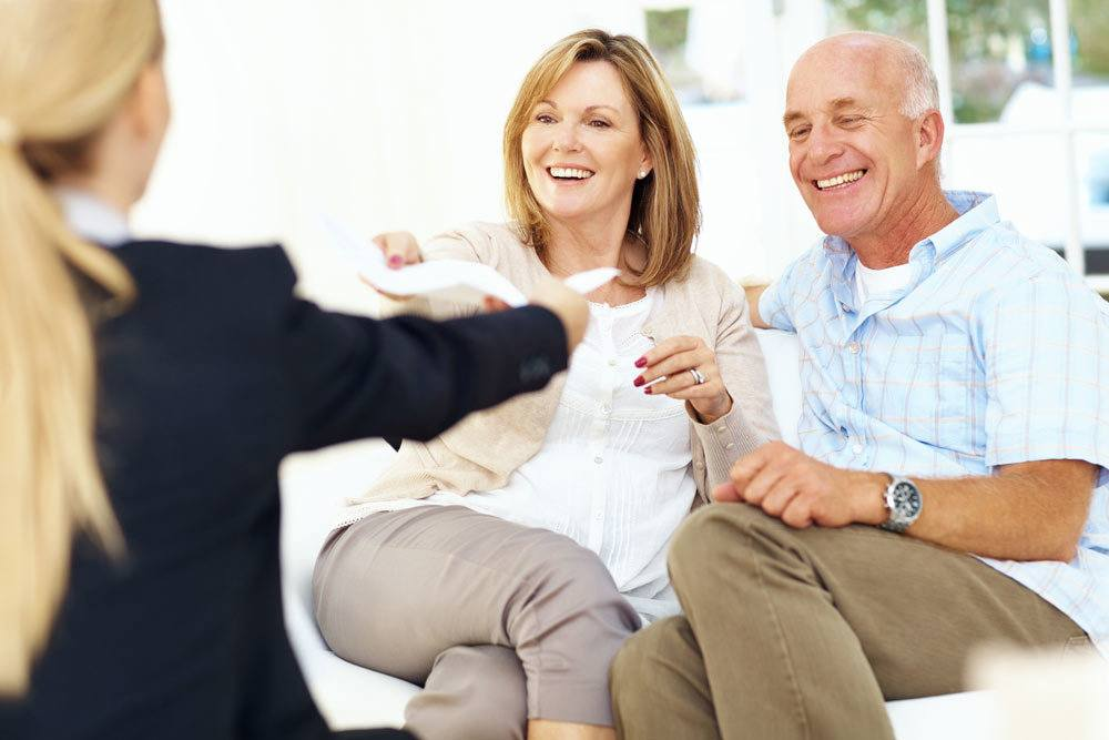 Insurance agent with senior couple